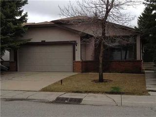 Photo 2: 4 WOODBROOK Way SW in Calgary: Bungalow for sale : MLS®# C3517374