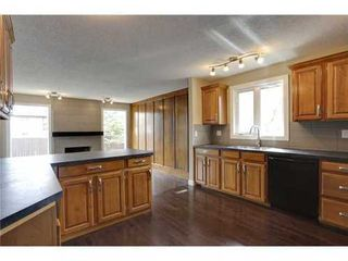 Photo 3: 4 WOODBROOK Way SW in Calgary: Bungalow for sale : MLS®# C3517374