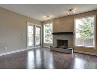 Photo 7: 4 WOODBROOK Way SW in Calgary: Bungalow for sale : MLS®# C3517374