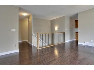 Photo 9: 4 WOODBROOK Way SW in Calgary: Bungalow for sale : MLS®# C3517374