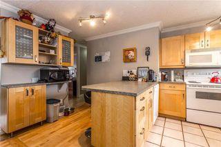 Photo 9: 536 BRACEWOOD Drive SW in Calgary: Braeside House for sale : MLS®# C4143497