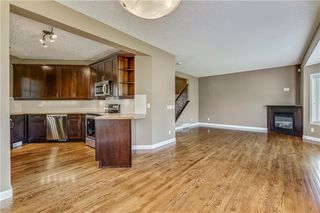 Photo 5: 45 PROMINENCE Park SW in Calgary: Patterson Semi Detached for sale : MLS®# C4249195