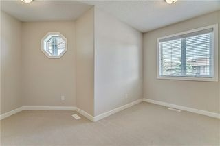 Photo 16: 45 PROMINENCE Park SW in Calgary: Patterson Semi Detached for sale : MLS®# C4249195