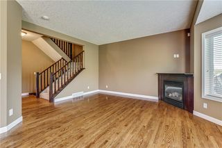 Photo 4: 45 PROMINENCE Park SW in Calgary: Patterson Semi Detached for sale : MLS®# C4249195