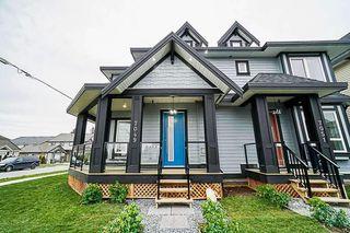 Main Photo: 7051 144A Street in Surrey: East Newton House 1/2 Duplex for sale : MLS®# R2384629