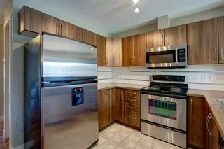 Photo 11: 48 CHAPARRAL RIDGE Park SE in Calgary: Chaparral Row/Townhouse for sale : MLS®# A1036010