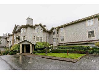 "Photo 1: 204 10721 139 Street in Surrey: Whalley Condo for sale in ""Vista Ridge"" (North Surrey)  : MLS®# F1439110"
