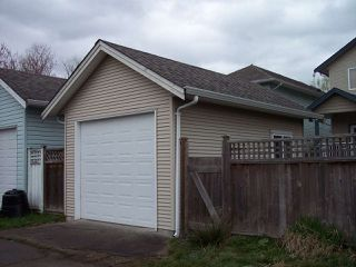 "Photo 2: 34628 7TH Avenue in Abbotsford: Poplar House for sale in ""Huntingdon Village"" : MLS®# R2048868"