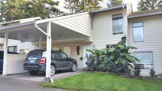 "Photo 1: 10 3075 TRETHEWEY Street in Abbotsford: Abbotsford West Townhouse for sale in ""Silkwood Estates"" : MLS®# R2094194"