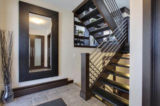 Photo 3: 19 828 Coach Bluff CR SW in Calgary: Townhouse for sale : MLS®# C3604172