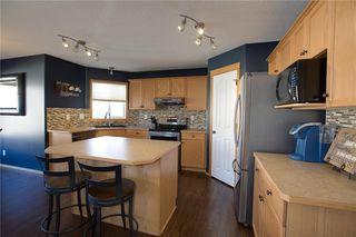 Photo 8: 425 STONEGATE Road NW: Airdrie Detached for sale : MLS®# C4214591