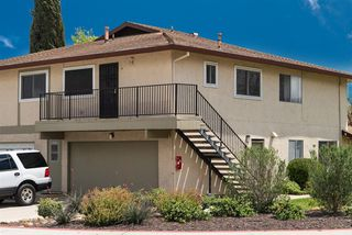 Main Photo: SANTEE Condo for sale : 2 bedrooms : 9842 Mission Greens Ct. #4