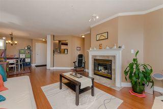 "Main Photo: 301 12155 75A Avenue in Surrey: West Newton Condo for sale in ""Strawberry Hill Estates"" : MLS®# R2379879"