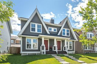 Main Photo: 157 AUBURN BAY Boulevard SE in Calgary: Auburn Bay Semi Detached for sale : MLS®# A1020476