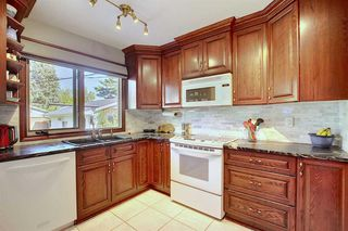 Photo 2: 2716 LOUGHEED Drive SW in Calgary: Lakeview Detached for sale : MLS®# A1032404
