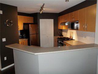 "Photo 2: 311 400 KLAHANIE Drive in Port Moody: Port Moody Centre Condo for sale in ""TIDES"" : MLS®# V870008"
