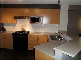 "Photo 3: 311 400 KLAHANIE Drive in Port Moody: Port Moody Centre Condo for sale in ""TIDES"" : MLS®# V870008"