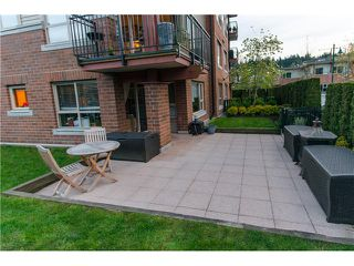 Photo 2: 111 200 KLAHANIE Drive in Port Moody: Port Moody Centre Condo for sale : MLS®# V1003995