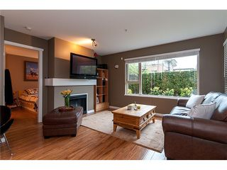 Photo 5: 111 200 KLAHANIE Drive in Port Moody: Port Moody Centre Condo for sale : MLS®# V1003995