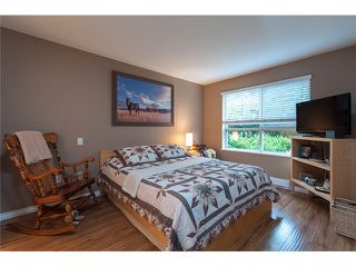Photo 8: 111 200 KLAHANIE Drive in Port Moody: Port Moody Centre Condo for sale : MLS®# V1003995