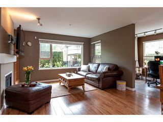 Photo 4: 111 200 KLAHANIE Drive in Port Moody: Port Moody Centre Condo for sale : MLS®# V1003995