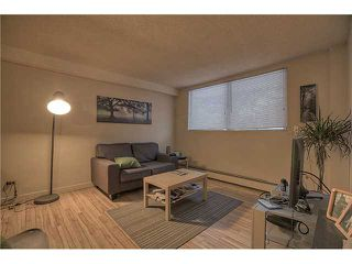 Photo 5: 717 17 Avenue NW in CALGARY: Mount Pleasant Multi-Family (Commercial) for sale (Calgary)  : MLS®# C1025103