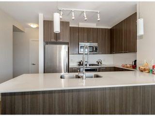 """Photo 2: 1207 2955 ATLANTIC Avenue in Coquitlam: North Coquitlam Condo for sale in """"OASIS"""" : MLS®# V1119402"""