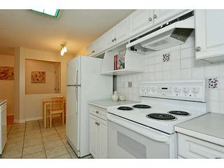 "Photo 6: 204 13870 70 Avenue in Surrey: East Newton Condo for sale in ""Chelsea Gardens - Mayfair"" : MLS®# F1445992"