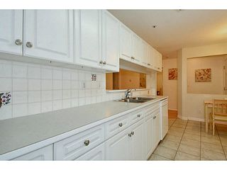 "Photo 5: 204 13870 70 Avenue in Surrey: East Newton Condo for sale in ""Chelsea Gardens - Mayfair"" : MLS®# F1445992"