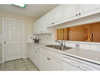 "Photo 4: 204 13870 70 Avenue in Surrey: East Newton Condo for sale in ""Chelsea Gardens - Mayfair"" : MLS®# F1445992"
