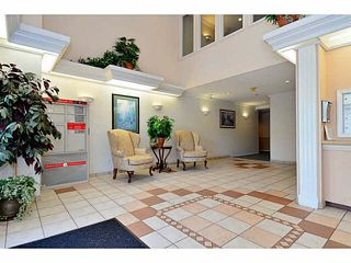 "Photo 2: 204 13870 70 Avenue in Surrey: East Newton Condo for sale in ""Chelsea Gardens - Mayfair"" : MLS®# F1445992"
