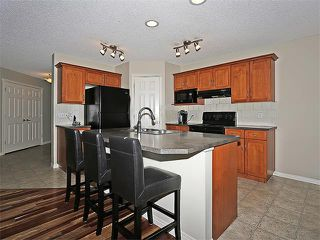 Photo 6: 222 TUSCANY RAVINE Close NW in Calgary: Tuscany House for sale : MLS®# C4046494
