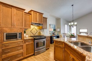 Photo 8: 215 Tuscany Glen Park NW in Calgary: Bungalow for sale : MLS®# C3614233