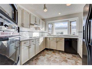 Photo 7: 313 WINDSOR Avenue: Turner Valley House for sale : MLS®# C4099234
