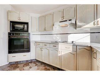 Photo 8: 313 WINDSOR Avenue: Turner Valley House for sale : MLS®# C4099234