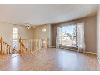 Photo 2: 313 WINDSOR Avenue: Turner Valley House for sale : MLS®# C4099234