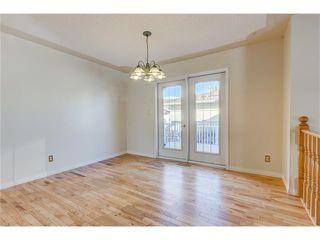 Photo 4: 313 WINDSOR Avenue: Turner Valley House for sale : MLS®# C4099234