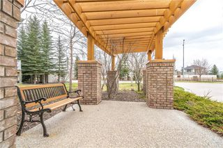 Photo 36: 81 CRYSTAL SHORES Cove: Okotoks Row/Townhouse for sale : MLS®# C4296195