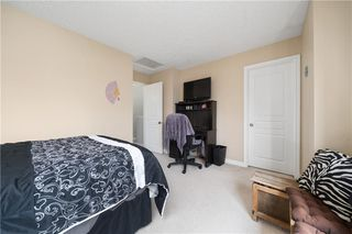 Photo 18: 81 CRYSTAL SHORES Cove: Okotoks Row/Townhouse for sale : MLS®# C4296195