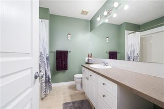 Photo 22: 81 CRYSTAL SHORES Cove: Okotoks Row/Townhouse for sale : MLS®# C4296195