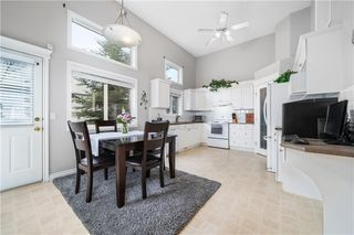 Photo 4: 81 CRYSTAL SHORES Cove: Okotoks Row/Townhouse for sale : MLS®# C4296195