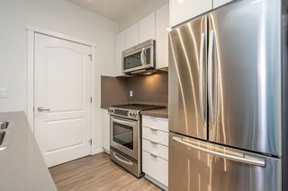 """Photo 5: 111 3107 WINDSOR Gate in Coquitlam: New Horizons Condo for sale in """"Bradley House at Windsor Gate"""" : MLS®# R2461759"""