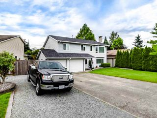 Photo 1: 21207 95A Avenue in Langley: Walnut Grove House for sale : MLS®# R2469328