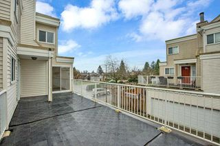 """Photo 1: 103 10091 156 Street in Surrey: Guildford Townhouse for sale in """"GUILDFORD PARK ESTATES"""" (North Surrey)  : MLS®# R2524886"""