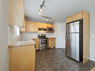 Photo 9: 43 EVERSYDE Heath SW in Calgary: Evergreen House for sale : MLS®# C4139021