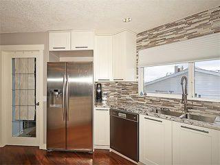 Photo 6: 7 TUSCANY RIDGE TC NW in Calgary: Tuscany House for sale : MLS®# C4112898