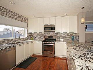 Photo 4: 7 TUSCANY RIDGE TC NW in Calgary: Tuscany House for sale : MLS®# C4112898