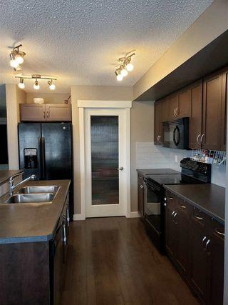 Photo 6: 3004 HARVEY Crescent in Edmonton: Zone 58 House Half Duplex for sale : MLS®# E4148670