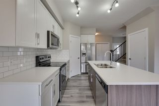 Photo 12: 8544 CUSHING Place in Edmonton: Zone 55 House Half Duplex for sale : MLS®# E4151840