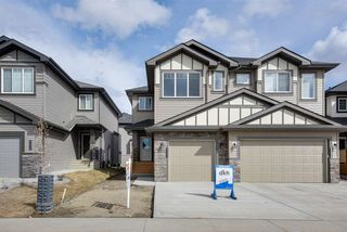 Photo 1: 8544 CUSHING Place in Edmonton: Zone 55 House Half Duplex for sale : MLS®# E4151840